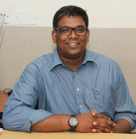 Dr. Naveen Alexander